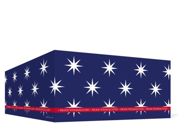 Geschäft Weihnachtskarten Big Stars, Außenansicht in Rot/Blau